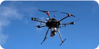 Drone with Phoenix LiDAR MiniRanger Unit attached